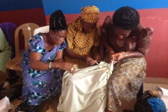 Widows prepare fabric for dyeing