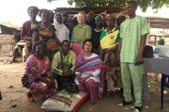 in the village. Handing over a sack of rice to the widows