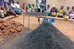 Training widows in the production of charcoal from biological waste